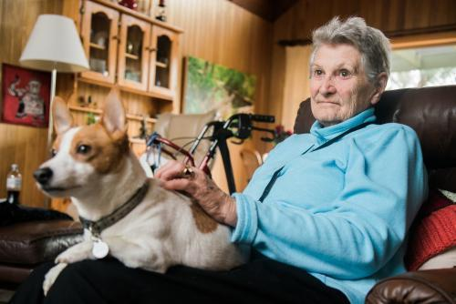 Elderly Woman with a Jack Russell on her knee