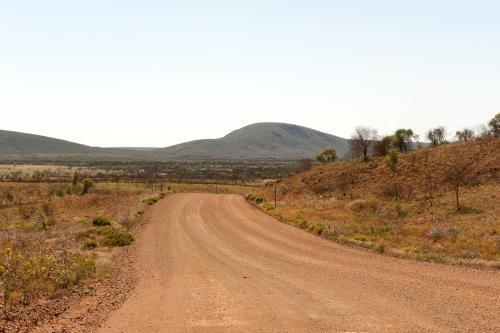 Empty Pilbara dirt road and landscape in early morning