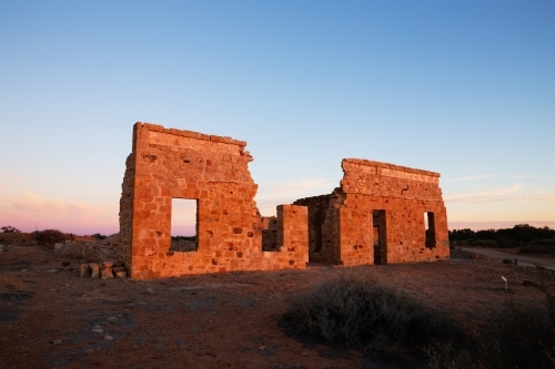 facade of old ruin in morning light