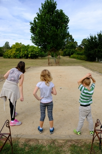 Family playing boules / petanque / bocce