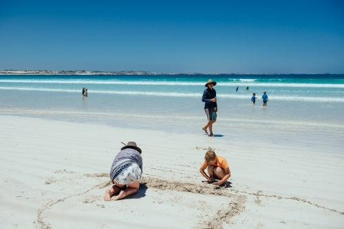 Family playing on Sensation Beach, Coffin Bay NP