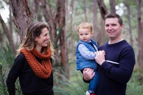 Family portrait in bush setting of Mum, Dad and toddler