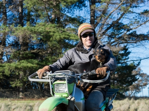 Farmer and his dog on a motorbike