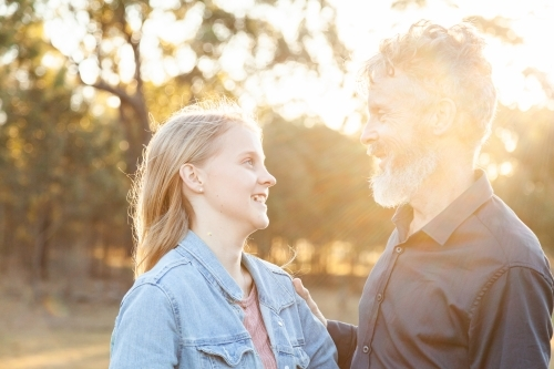 Father and daughter together in golden afternoon light
