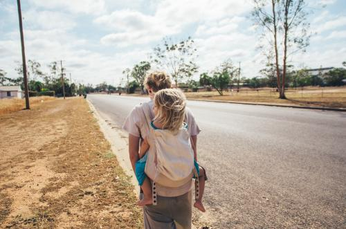 Father and daughter walking on rural streets