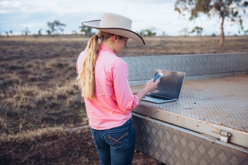 Female farmer using technology