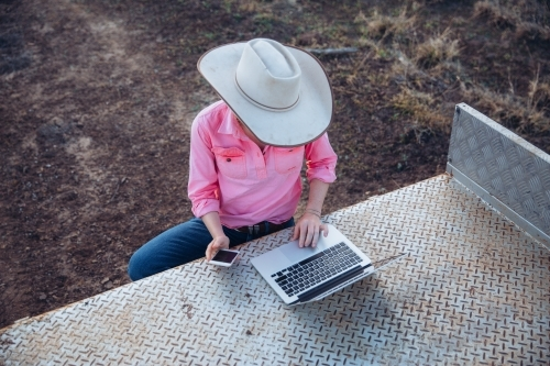 Female farmer using telecommunications device