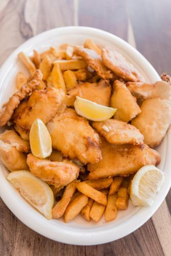 fish and chips in a large dish