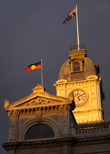 Flags flying above a heritage building