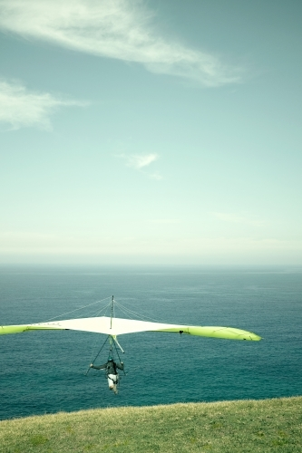 Hang glider taking off to the horizon on a beautiful day