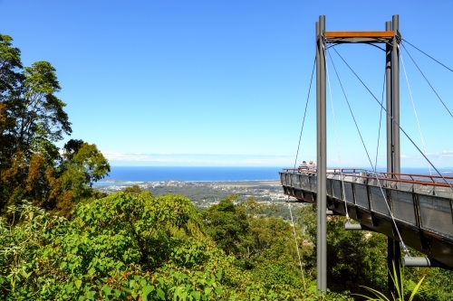 Two mature people standing on Forest Sky Pier overlooking Coffs Harbour on the NSW coast