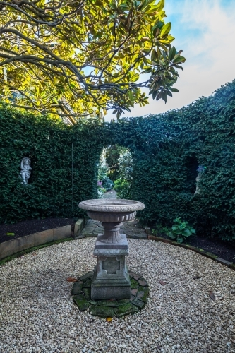 Fountain in hedged garden of historic Corinda accommodation in Hobart