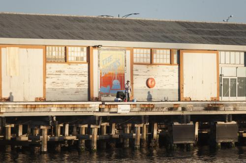 Man fishing from a pier at Fremantle Ports