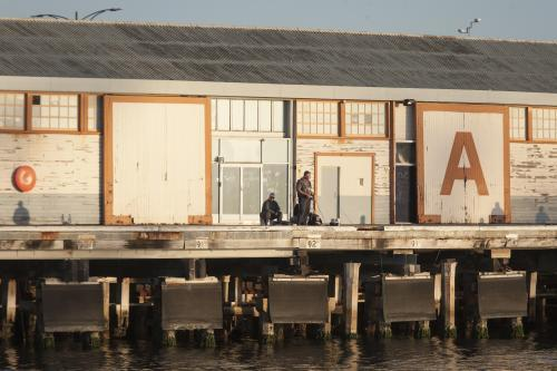 man fishing near A Shed at fremantle