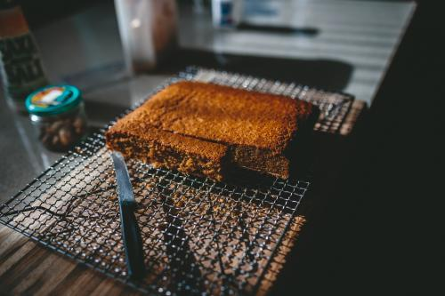 Freshly baked cake being cut