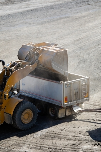 Front end loader loading a truck in mine