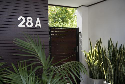Front entry to stylish home unit with plants