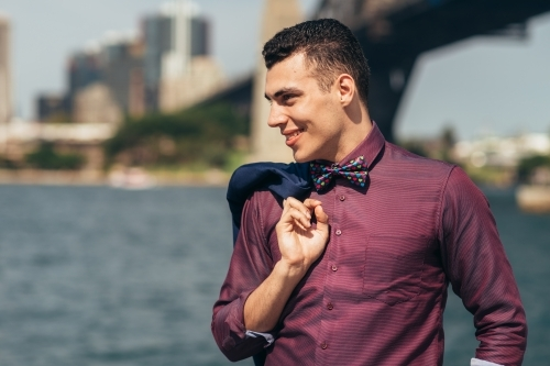gay young man standing by sydney harbour
