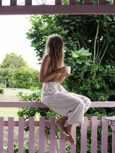 Girl drinking tea on veranda