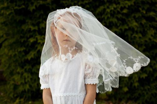 Girl in a communion veil