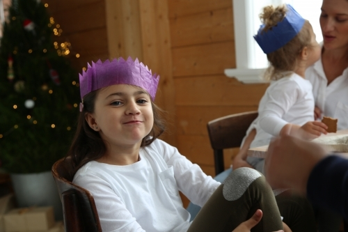 Girl looking at camera in Christmas hat