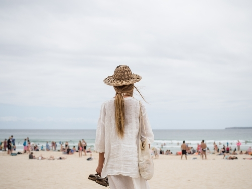 Girl looking on to busy Bondi beach