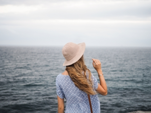 Girl looking out to ocean