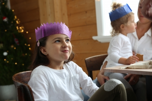 Girl smiling in Christmas hat