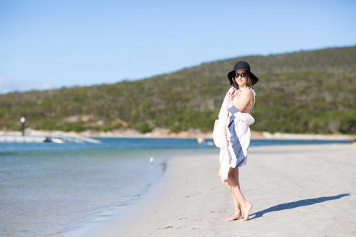 Girl wearing hat on beach at Emu Point