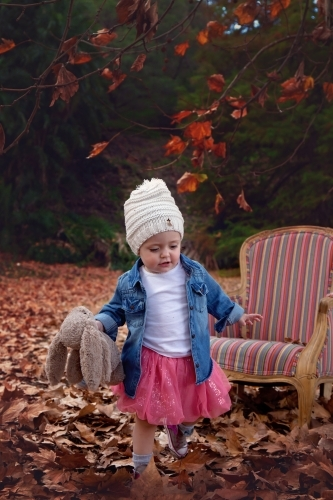 Girl With Hat Running in Autumn Leaves