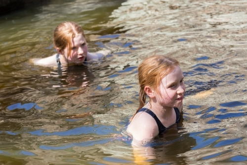 Girls swimming in a waterhole in inland Australia