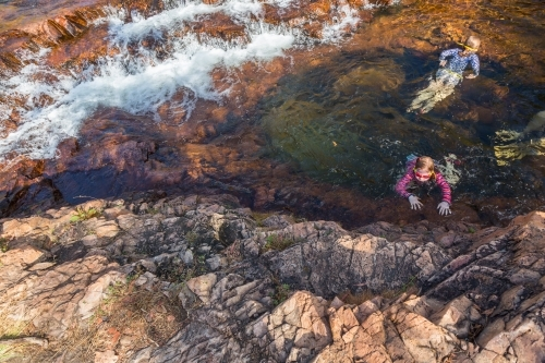 girls  swimming in a waterhole in Litchfield national park, northern territory