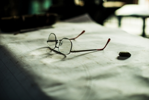 Glasses sitting on technical plans
