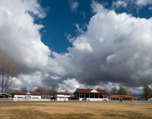 Large billowing clouds over the Glen Innes showground pavilion