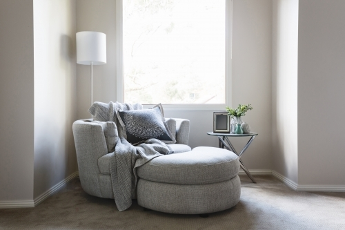 Gorgeous bedroom sofa chair with throw rug and cushion
