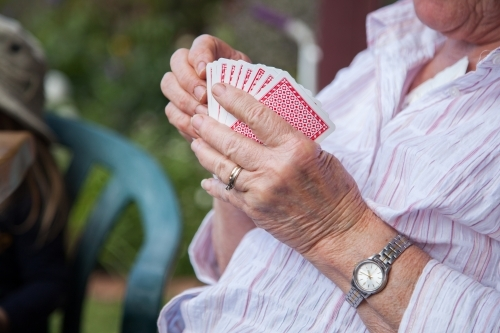 Grandmother holding a hand of cards