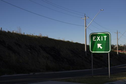 Green exit road sign