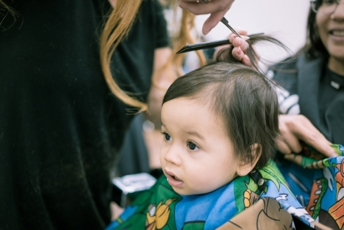 One year old mixed race baby boy has his first haircut