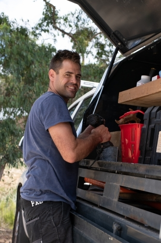 Happy tradie with his work ute