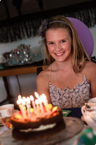 happy tween with birthday cake