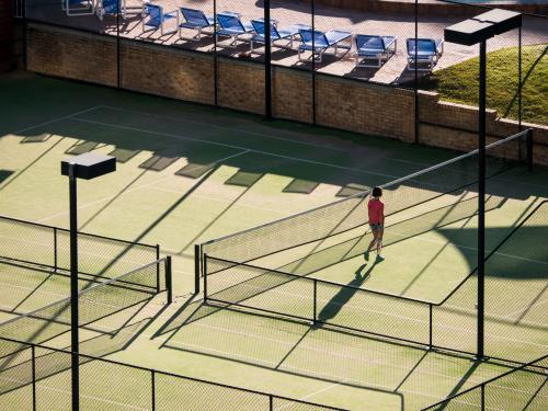 High view of tennis courts with long shadows