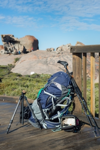 Hiking and photography equipment on boardwalk trail in bushland