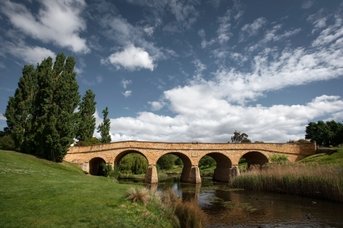 historic arch bridge over a river
