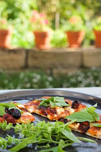 Homemade pizza with rocket salad