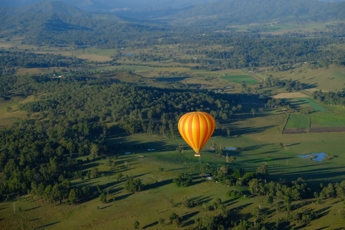 Hot air balloon over the lush green Gold Coast / Scenic Rim hinterland