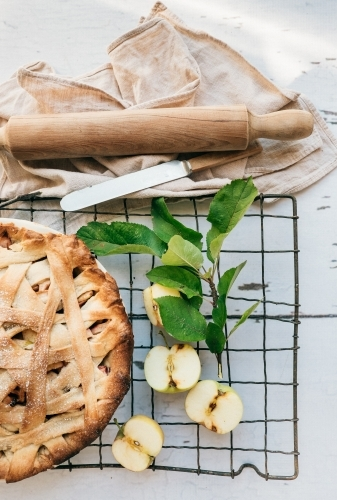 Hot apple pie cooling on a rack.