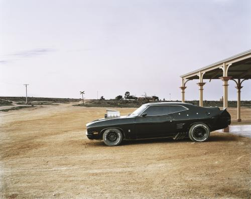 Hotted up black car in remote outback town