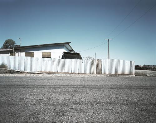 House with metal fence in outback town
