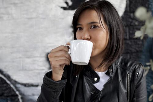 Woman drinking coffee from a mug