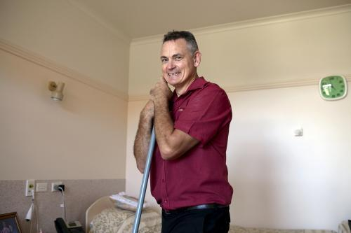 Portrait of Male Nursing Home Staff Member Doing Cleaning Rounds